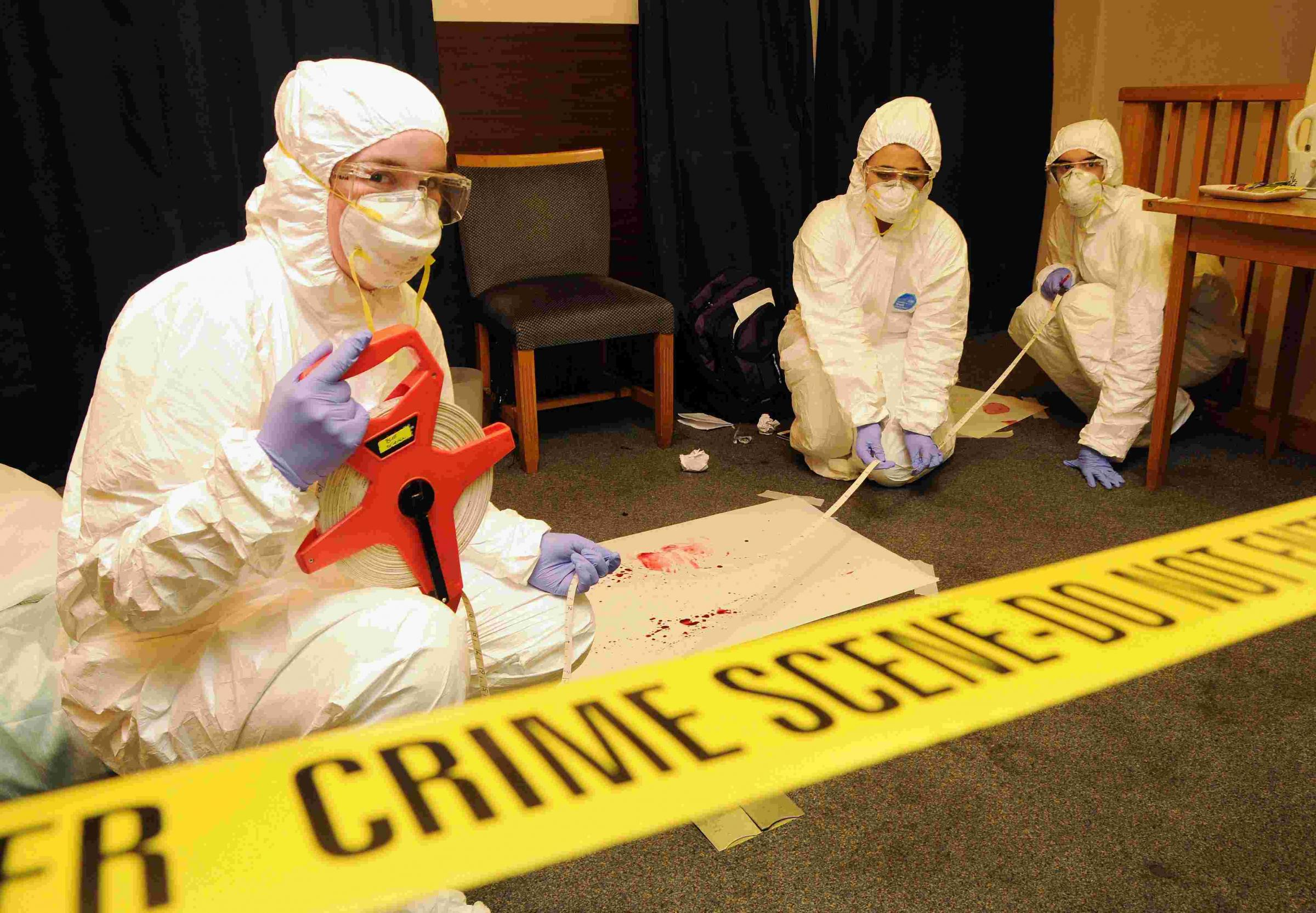 Melanie Patterson, Georgie Holder and Thomas Ash gather evidence in the hotel