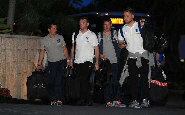 Luke Shaw, right, arrives in Miami with the rest of the England squad this morning.