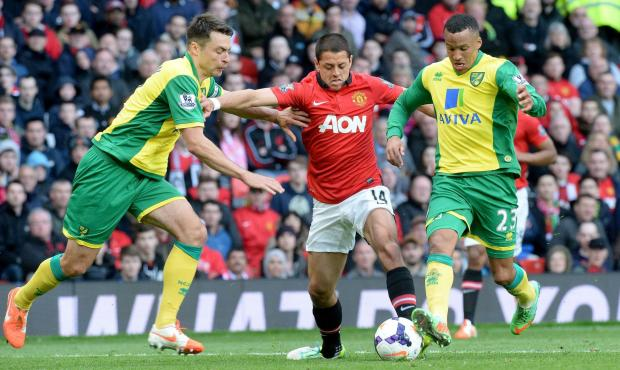 Javier Hernandez, middle, in action for Manchester United
