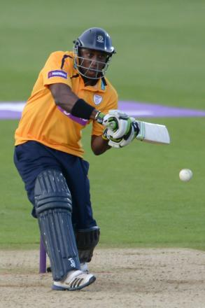 Michael Carberry's 55 could not prevent a big Hampshire defeat