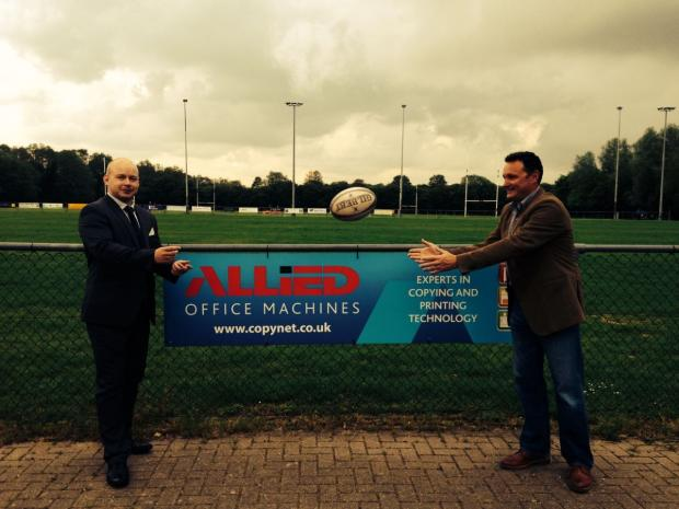 Ben Welch, WRFC sponsorship manager and senior player (left) passes to regional sales manager for Allied Office Machines, and fellow Wintonian, Steve Richmond (right)