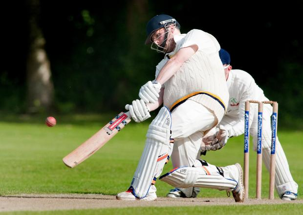 Basingstoke Gazette: Skipper Mike Adams hits a six off the last ball of Andover's innings against Liphook