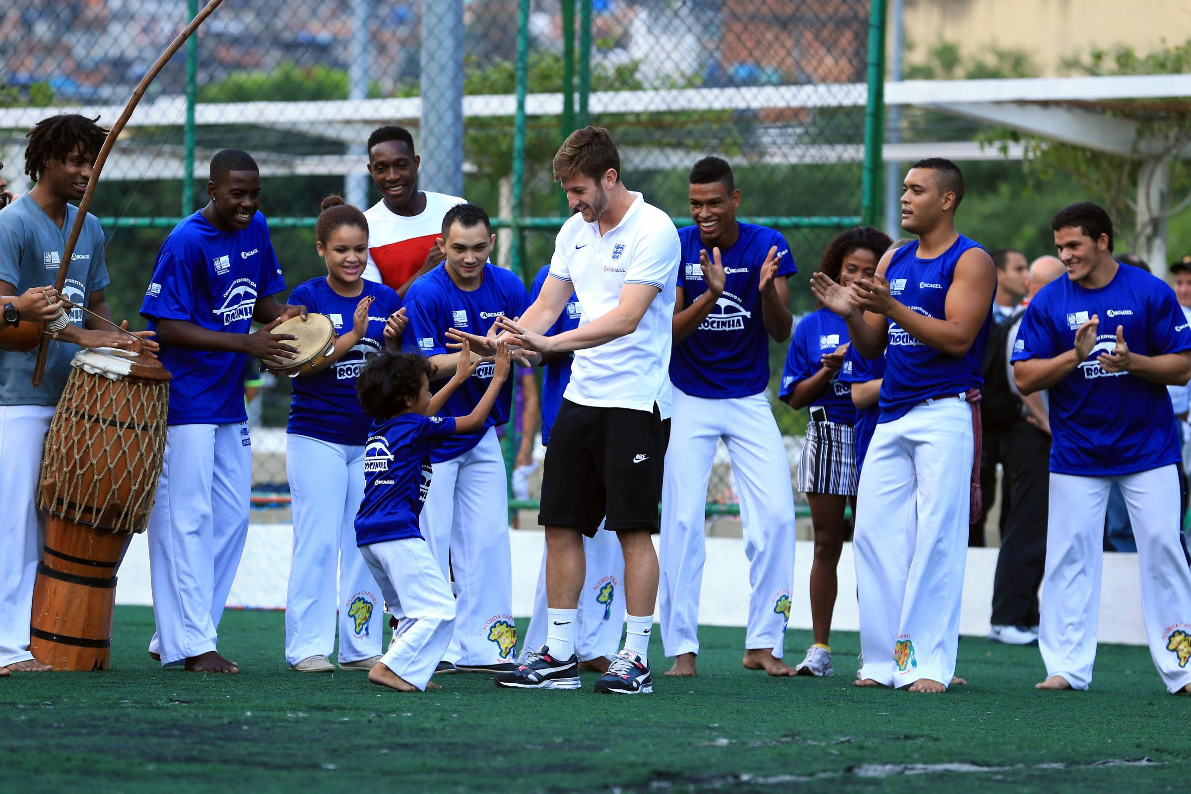 Saints captain Adam Lallana dances with Brazilian children