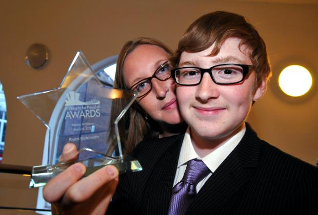 Ryan Robinson with his mum, Karen, after winning the Young Achiever Award