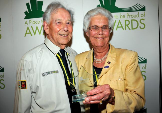 Michael and Beryl Mullender with their award