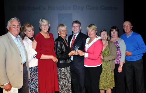 Thom Thorp, from Lilly, presents volunteers and staff from St Michael's Hospice with the Health and Care Award
