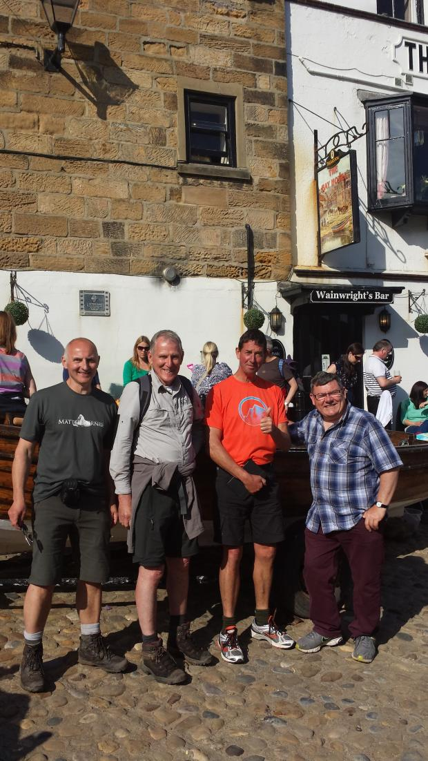 Basingstoke Gazette: Geoff Wride (second from left) with three walkers from Cumbria who accompanied him on the final stages of his marathon march
