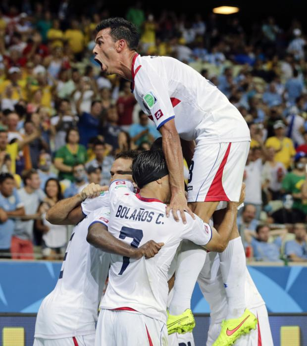 Basingstoke Gazette: Costa Rica celebrate their third goal