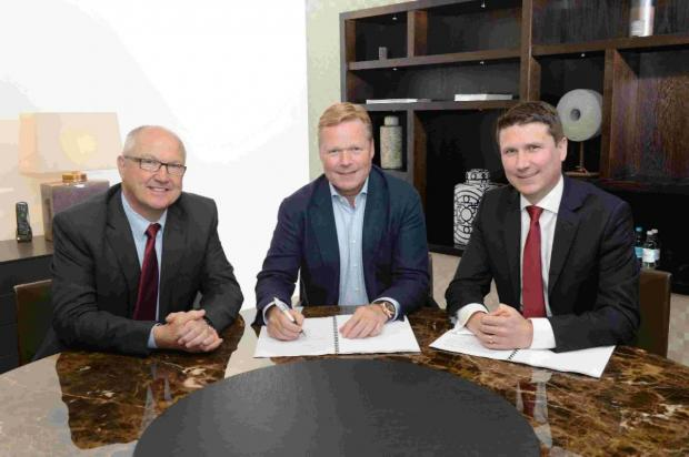 Basingstoke Gazette: Ronald Koeman with Saints director Les Reed, left, and CEO Gareth Rogers.