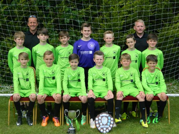 Andover New Street U11s are pictured with the Peter Houseman Youth League winners and League Cup trophies after a fine season.