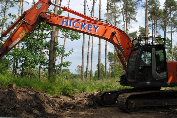 A digger on the land near Sherfield Park where about 250 trees have been felled
