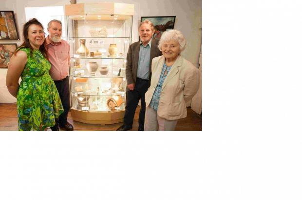 Basingstoke Gazette: Anne James, manager, Kevin Stubbs, archeologist, Dave Allen, chief archeologist at Hampshire County Museums Service, and Barbara Burnbridge, trustee and local historian, with the artefacts recently returned to King John's House  in Romsey