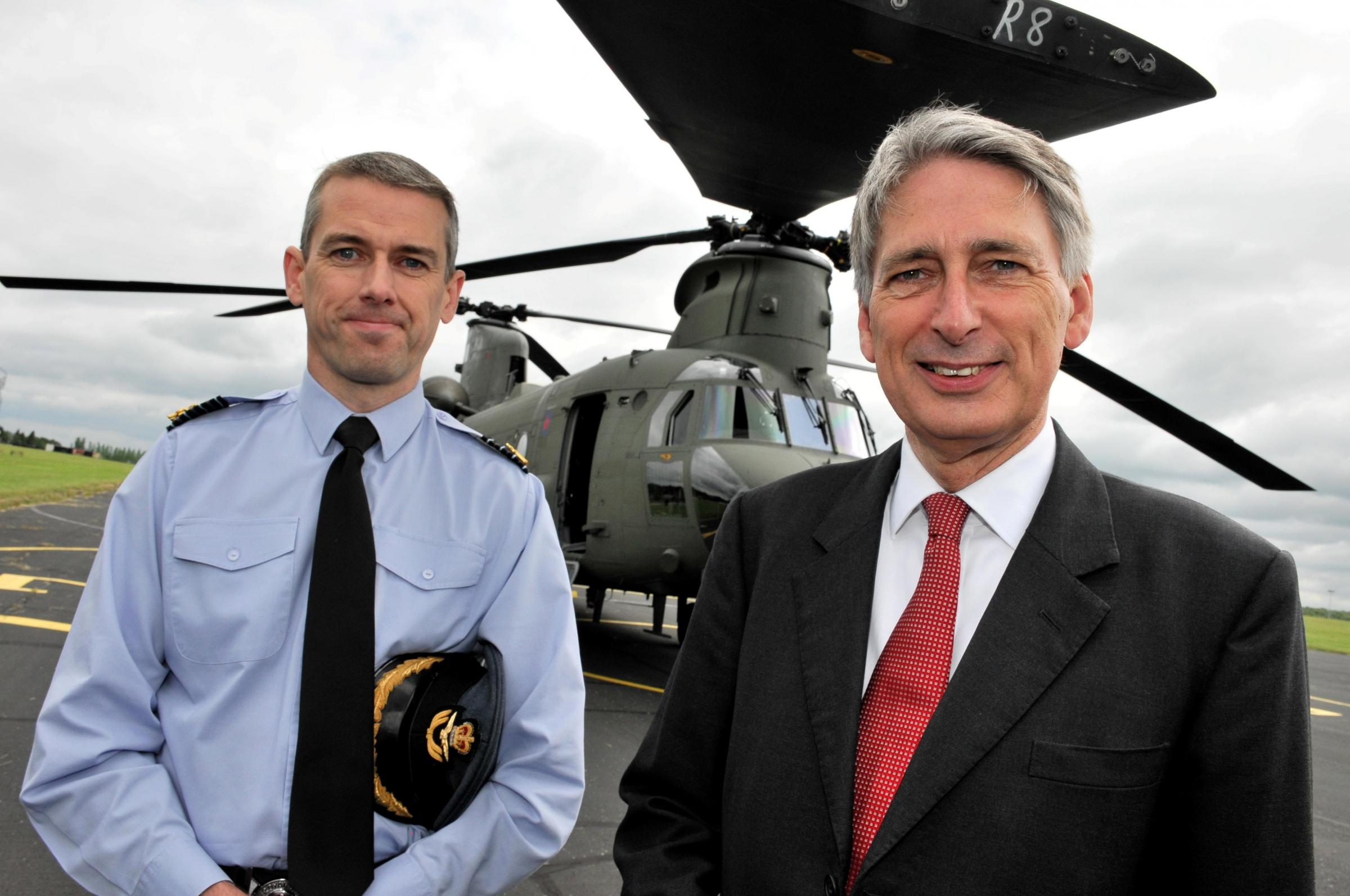 Group Captain Richard Maddison, RAF Odiham Station Commander, with Philip Hammond, Secretary of State for Defence, right