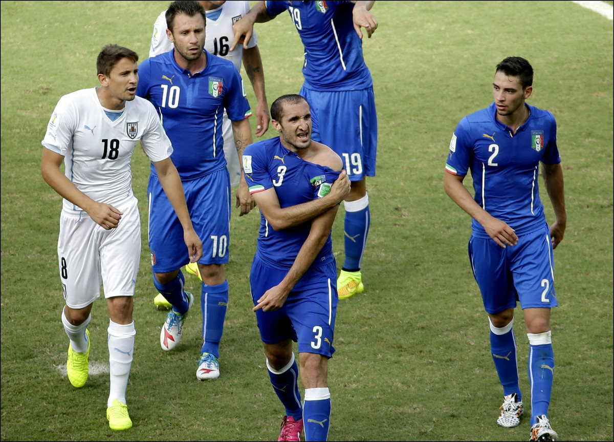 Gaston Ramirez, left, confronts Giorgio Chiellini.