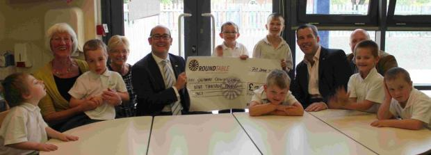Members of Winchester Round Table and sponsors with children at Shepherds Down School