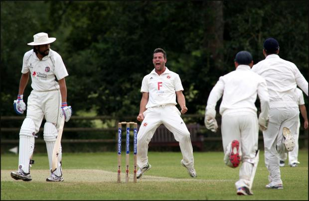 Spencer Champ celebrates after taking a wicket against Hursley Park