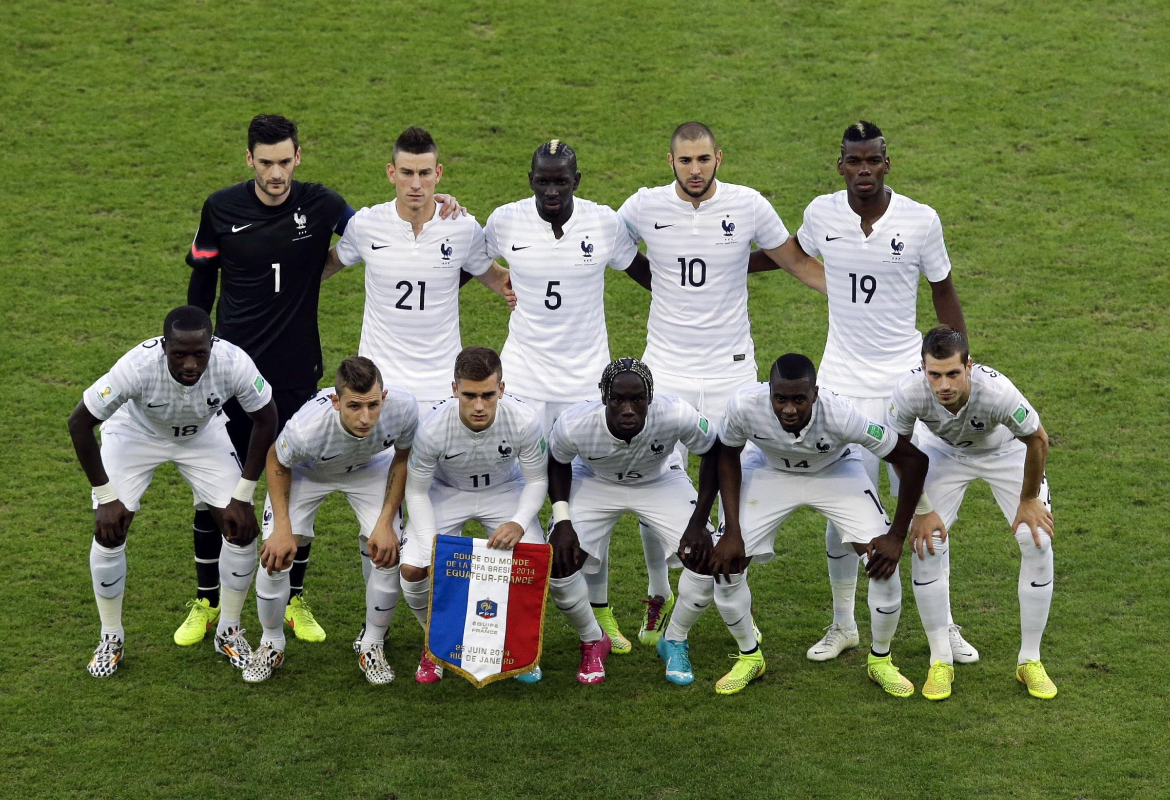 Morgan Schneiderlin, front row far right, lines up with the French team ahead of last night's draw with Ecuador