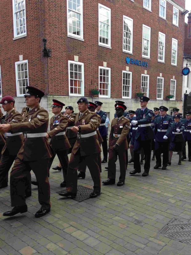 Basingstoke Gazette: The flag raising ceremony took part outside the Great Hall