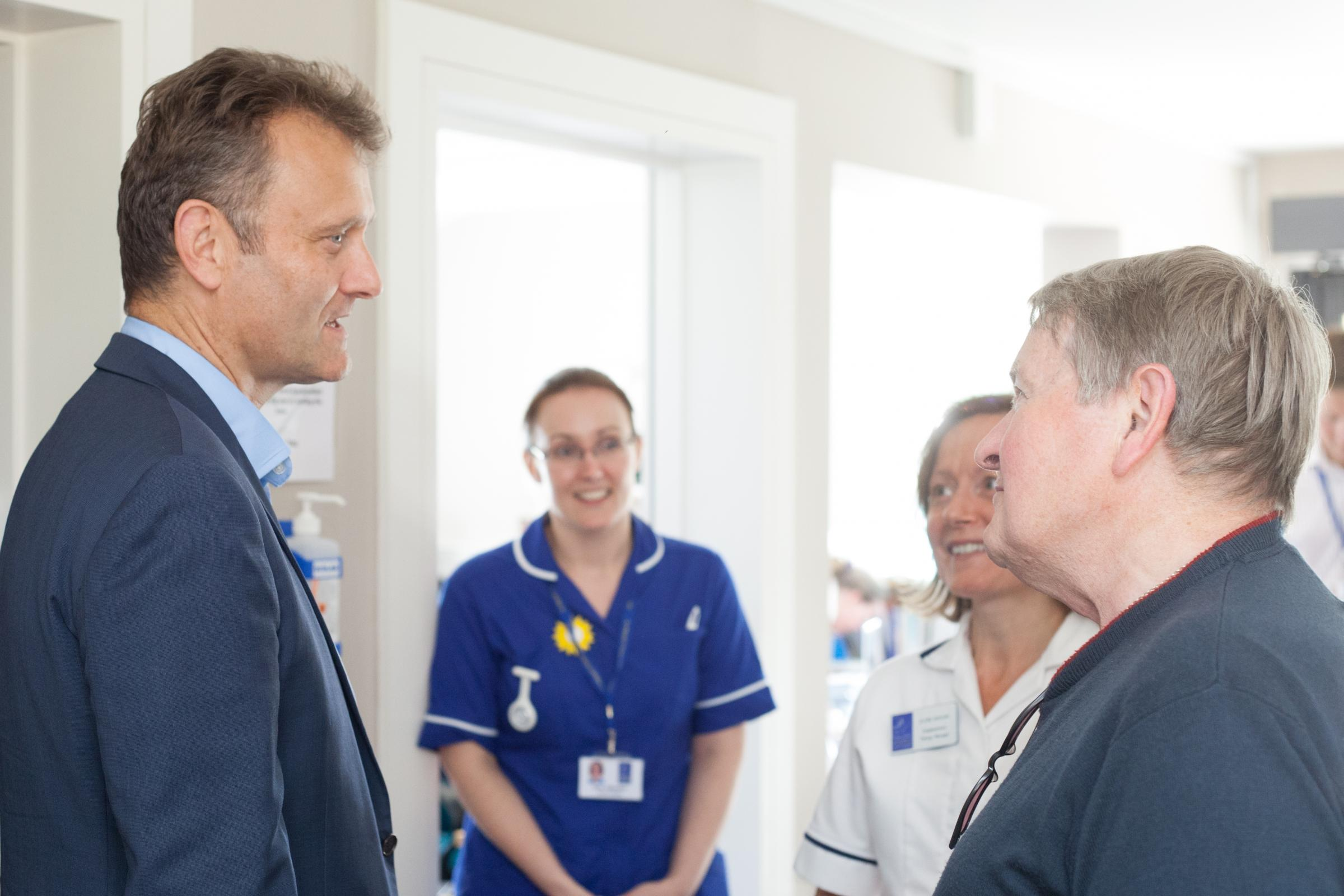 Hugh Dennis chats to members of the hospice staff