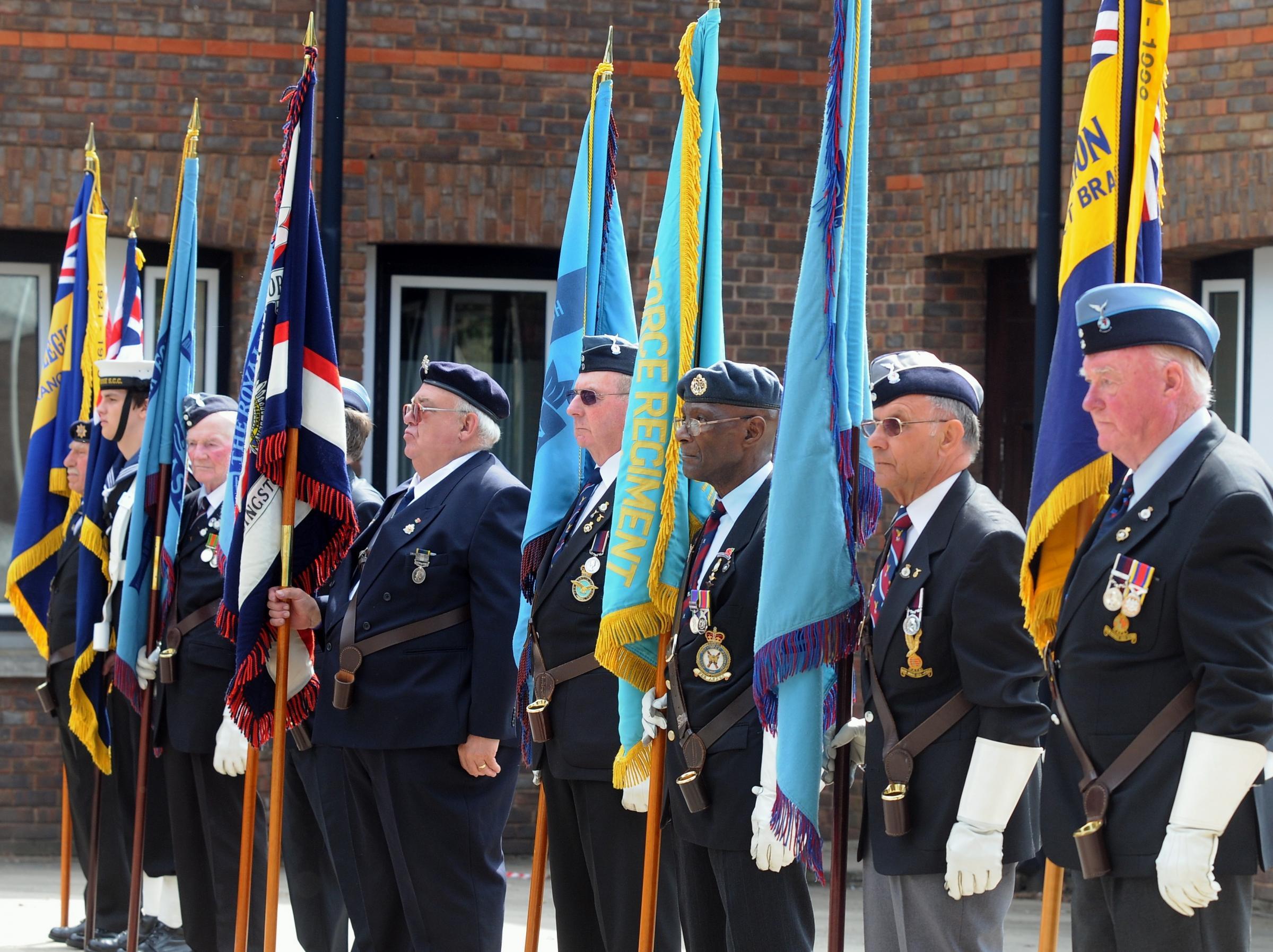 Veterans stand in silence to remember their fallen comrades