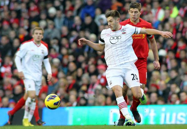 Adam Lallana challenges new team-mate Steven Gerrard during Liverpool's 1-0 win over Saints in 2012.