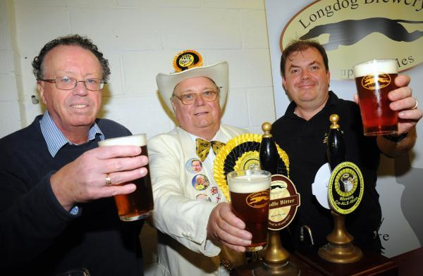 Derrill Carr from CAMRA, Howling Laud Hope, the leader of the Official Monster Raving Loony Party, and Phil Robins, owner of Longdog Brewery