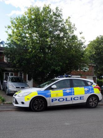A police car parked outside the house in Frescade Crescent, Kings Furlong, this morning