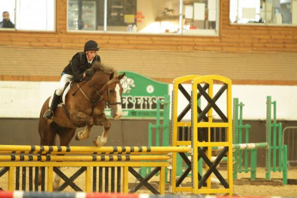 Bradley Sutton in show jumping action