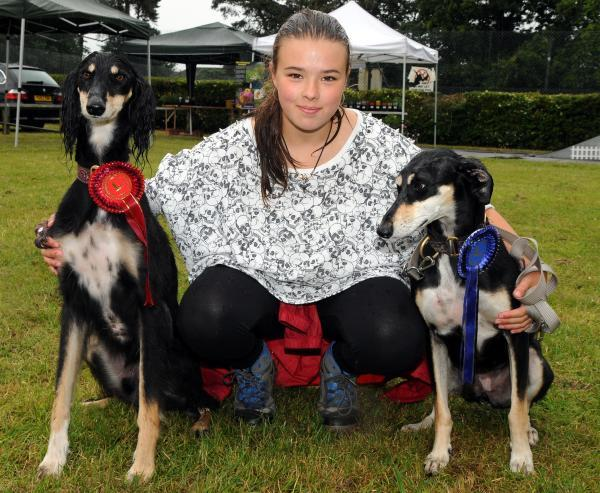 Phoebe Rolfe, 11, with her dogs Dylan and Millie