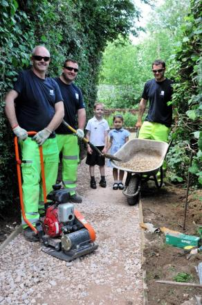 Pupils Freddie Wright, five, and Sienna Shepherd, four, with Rob Pipitone, Jason Underdown and Will Troester, from EM Highway Services Ltd
