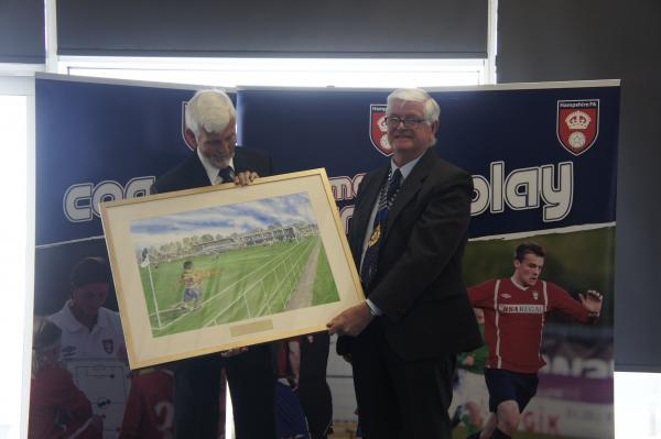 John Ward is presented with a picture of the county headquarters