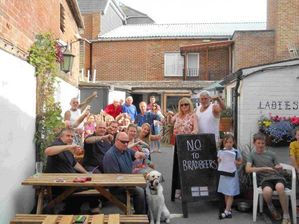 Basingstoke Gazette: Angry customers at the Tudor Rose pub fear the shop extension will throw the beer garden into darkness