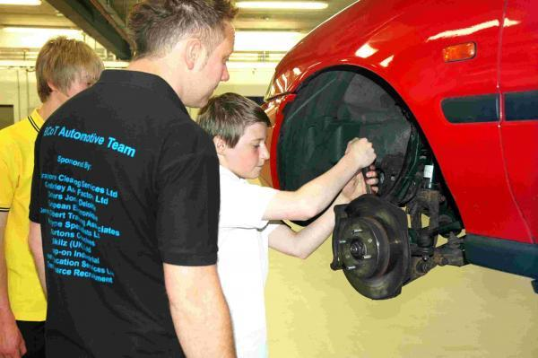 Callum, from Perins School, in the automotive workshop, under the direction of Phil Wilkes