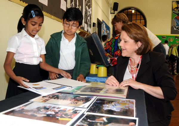 Basingstoke MP Maria Miller looks at some of the pupils' project work