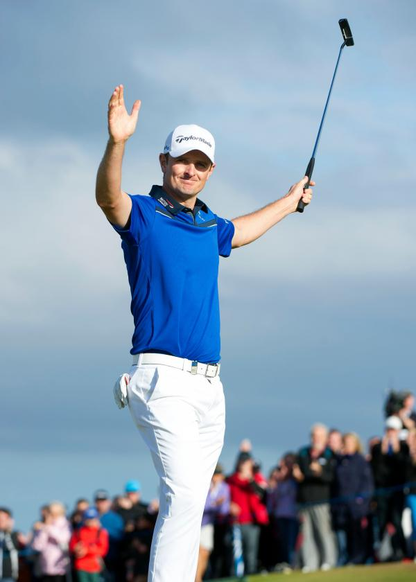 Justin Rose celebrates holing the winning putt at the Scottish Open