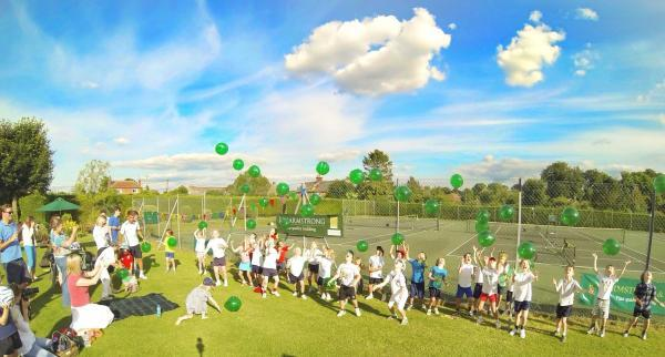 Young players release balloons before the start of the tournament