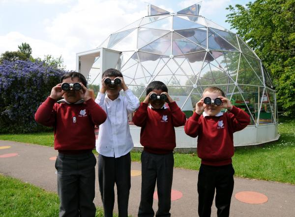 Pupils from Park View Infants bird watching in front of the school's solar dome