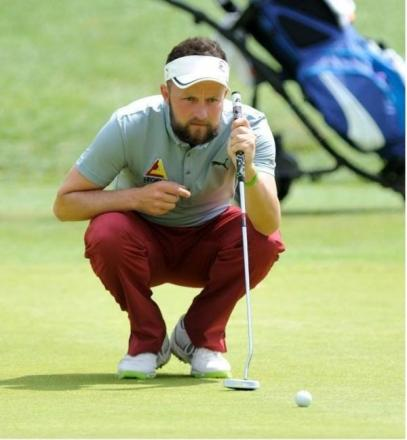 Stuart Archibald lines up a putt at the Dartford Pro-Am
