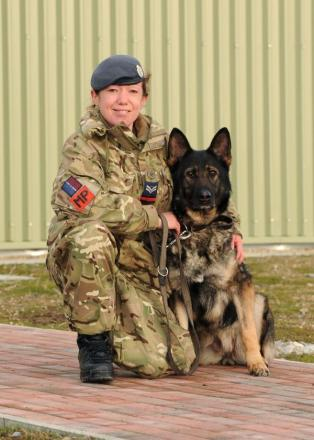 Corporal Laura Willetts with her German Shepherd Ordy