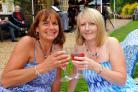 Annette Matthews and Sharon Stickland enjoy a picnic and live music