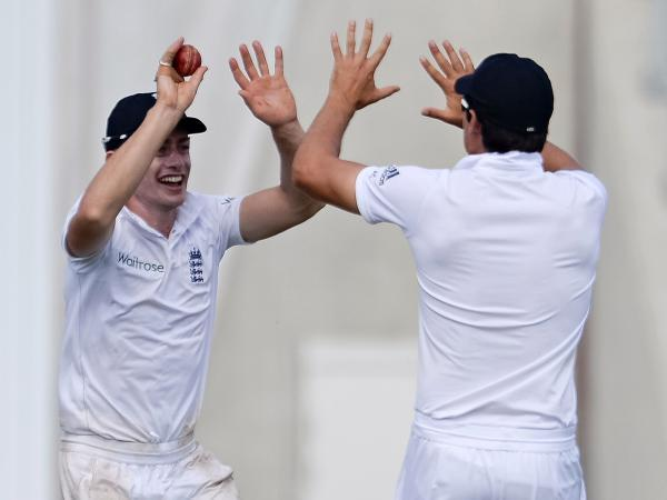 Sean Terry celebrates with Alastair Cook after taking a catch as England's 12th man last week (LMI Photography)