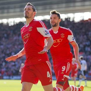 Basingstoke Gazette: Southampton chairman Ralph Krueger has said neither Morgan Schneiderlin, left, nor Jay Rodriguez will be leaving St Mary's