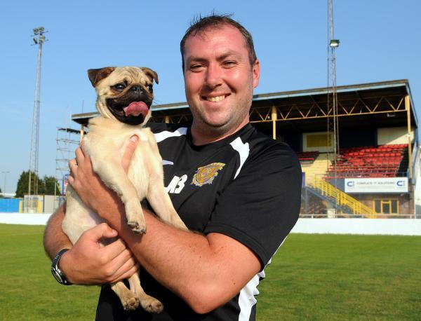 Basingstoke Town manager Jason Bristow with his newest signing - Doug the Pug