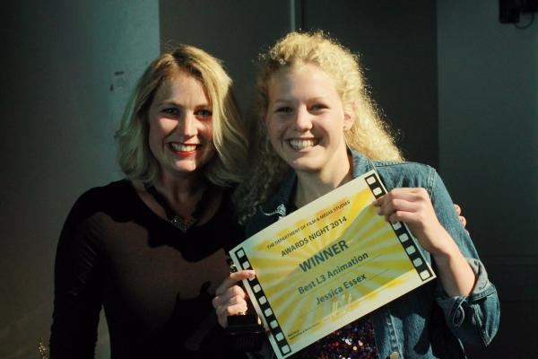 Jessica Essex receives her award for Best Animation from teacher Lucy Poynter.