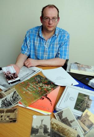 David Stewart with some of his research material. The picture he is holding is of Percy Ewart Dear, of the 2nd/4th Hampshire Regiment, who died in Palestine, on November 22, 1917, aged 21.