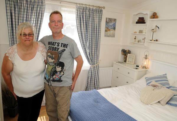 John O'Brien and Tina Carrington in their redecorated bedroom