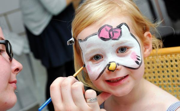 Isla Dutton, three, has her face painted