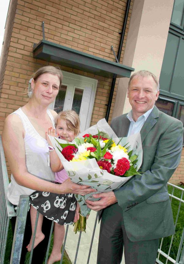 Sentinel chief executive Mark Perry presents Sabrina Cooke with a bouquet to welcome her to her new home