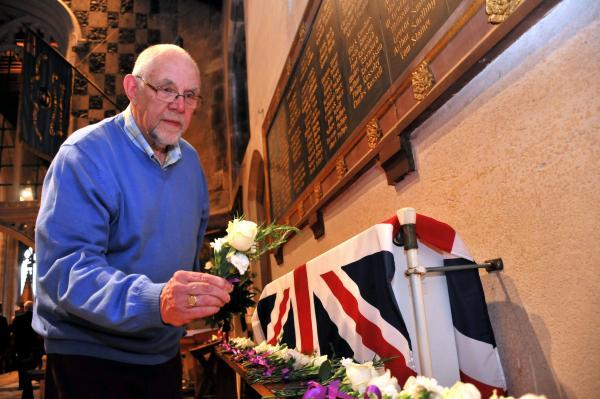 Mick Smith lays a floral tribute in memory of Basingstoke and Deane people who lost their lives during the First World War