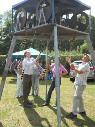 Lockerley and East Tytherley bellringers challeneged of fete-goers to have a go themselves on a mini ring of eight small bells.